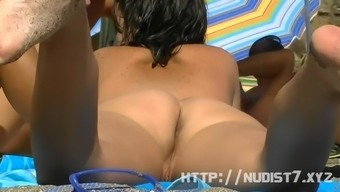 This adorable brunette nudist chicks is smearing lotion