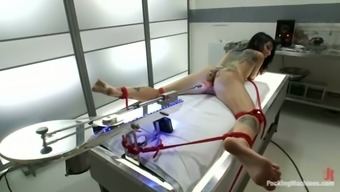 Booty siren gets bondage and drilled by a machine