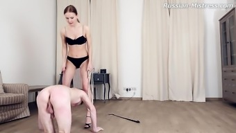 Smart foot fetish diva with natural tits spanking her slave superbly in BDSM