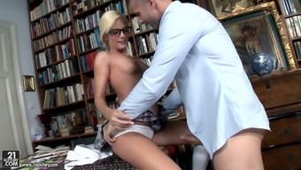 Nerdy librarian in glasses Candee Licious is fond of big and hot dick