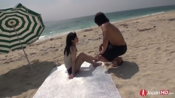 Japanese babe Hina Maeda is having crazy sex on the beach