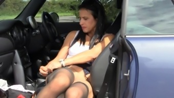 British slut Anna plays with herself in a layby in a car