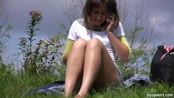 Clothed babe is talking on the phone