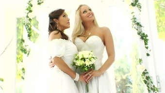 Staggering scene with two busty lesbian brides