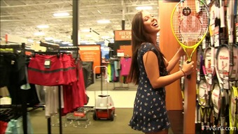 Flashing at the sporting goods store in a short dress