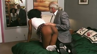 Horny professor hits her slave with the leather belt