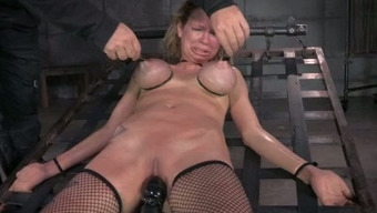 Big breasted mommy with nipple clamps on and gets her muff toyed