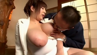 Ran Niyama shows off her monster tits while satisfying on older guy