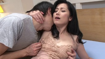 Pretty Japanese milf moans with a cock fucking her pussy
