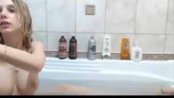 Two young lesbians playing dildos on bath SexoWebcam.Online