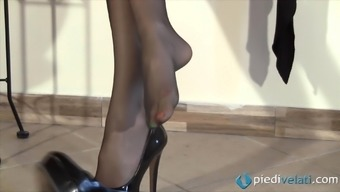A girl in nylons shows off her crazy painted toes and feet