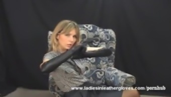 Gorgeous Milf puts on sexy leather gloves and turns into fetish mistress