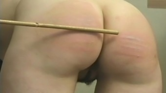 Schoolgirl bottom spanked and caned