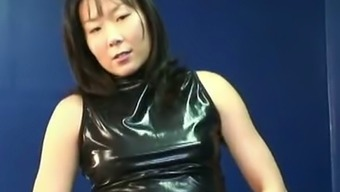 Seductive Korean MILF in latex dress playing with her pussy