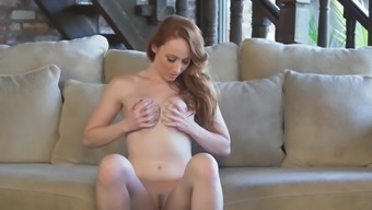 Redhead plays with her pussy in harsh manners
