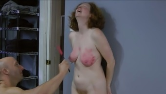 My raunchy looking slave knows what titty spanking is all about
