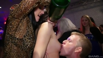 Stunning amateur porn hotties gives hard dick a good blowjob in group club orgy
