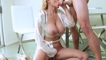 Big breasted MILF takes this young man to the edge by offering him sex