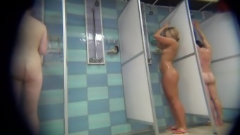 Spying on a tanned blonde with tight body in the shower.
