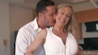 Brandi Love is a gorgeous MILF who wants to ride a dong