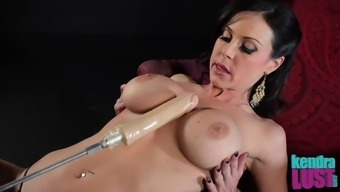 Kendra Lust bends over for a couple of stiff sex toys