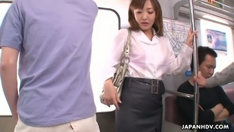 Slutty Japanese chick Mami Asakura is fucked by several strangers in the subway car