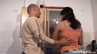 Chubby wife is fucked by horny husband right on the kitchen table