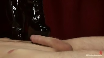 guy gets a blowjob and then put in a pillory to get his ass fucked by tranny