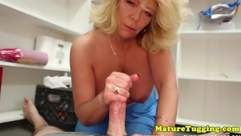 Mature stepmom milks stepson oiled cock POV