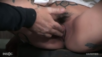 Brutal pussy masturbation of tied up tattooed whore Leigh Raven