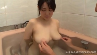 Fancy Asian bimbo enjoying her big soapy tits being caressed gently in the shower