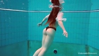 Seductive red haired swimmer Katrin Bulbul gets naked under the water