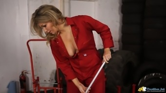 Naughty lady in red overalls Penny Lee exposes boobies during cleaning