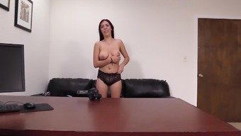 Redhead babe Celine strips on the casting couch and gets fucked rough