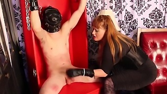 Mistress in leather gloves slaps, smacks and stomps on her slaves balls