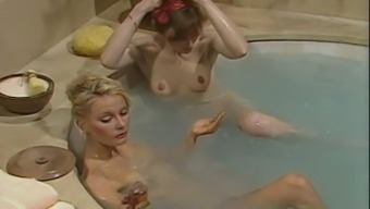 Lesbians enjoy fondling and licking madly in bathroom retro scene
