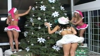 Sexy Santa girls play lesbian games after dancing near Christmas tree