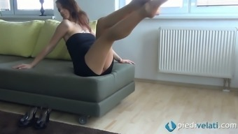 We get a hot upskirt while she shows her legs and feet