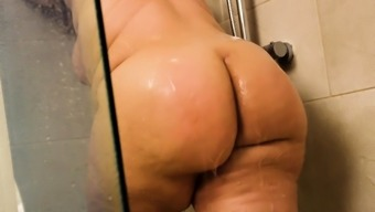 Showering curvy babe