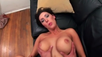 busty brunette Dylan Ryder jumping on a friend's hard cock after blowjob