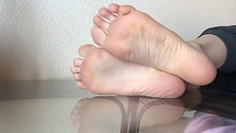 Foot fetish. Soles on table