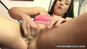 Alluring bruntte with nice round butt pees in a condom
