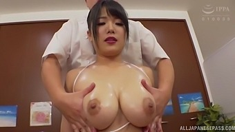 Sachiko goes to get a back massage but gets her round tits caressed